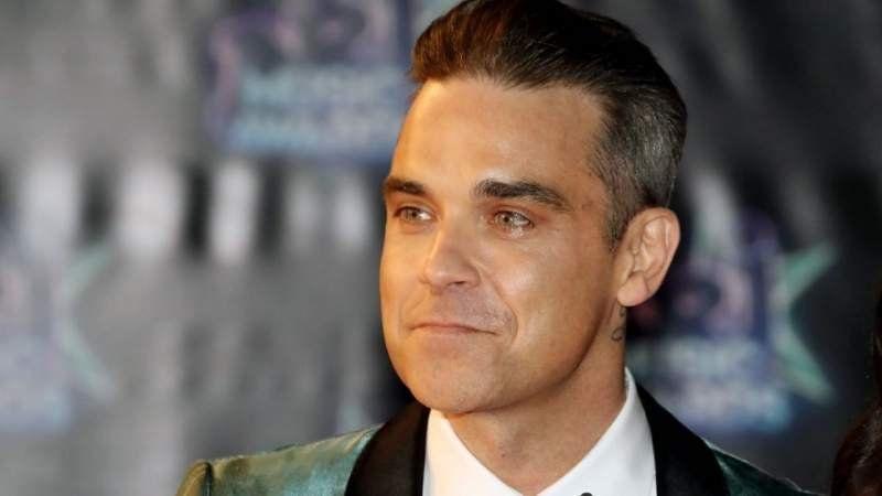 Robbie Williams contrató guardaespaldas por miedo a los ovnis